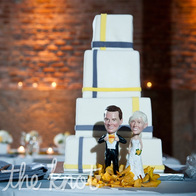 Mod stripes on plain white fondant let the cake take a backseat to the star of the table: a pair of bobbleheads in the couple's likenesses.