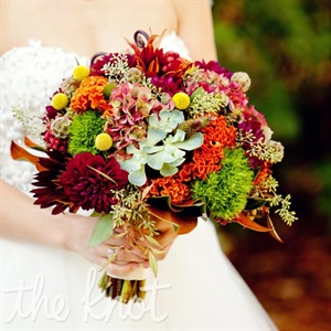 Meagan carried textured flowers like hydrangeas, craspedia, cockscomb, succulents, and dahlias in every autumn color.