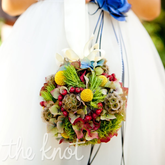 Drew's goddaughter walked down the aisle carrying a rustic pomander of foliage to match the boutonnieres.