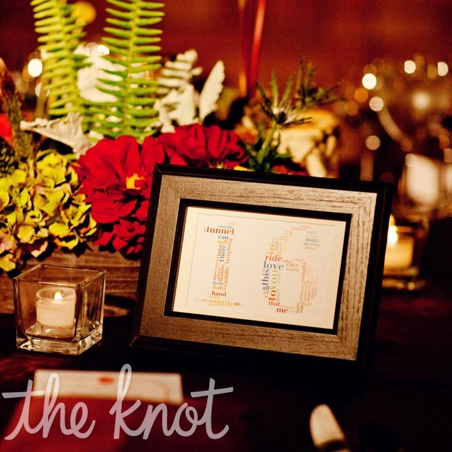 The framed table placards were printed with lyrics from the couple's favorite love songs shaped into numbers.