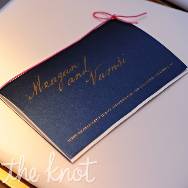 Navy-covered booklets tied with coral ribbon held the ceremony details.
