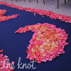 At their Hindu ceremony, the aisle was decorated with fresh petals arranged in a paisley pattern.