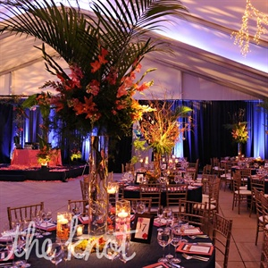 Since the ceilings were so high, the couple chose soaring, colorful centerpieces to help fill the space.