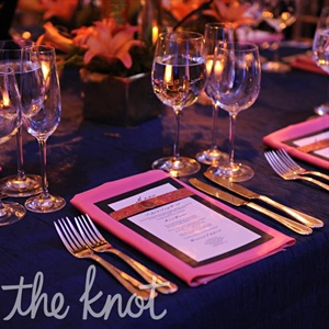 The coral-pink napkins popped against the navy tablecloths.