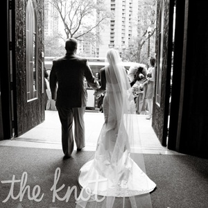 "Sarah's veil philosophy was ""Go big or go home,"" so she chose one that was four feet longer than her dress."