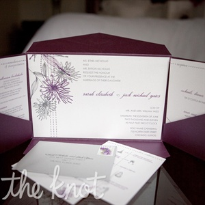 All of the pieces in the invitation suite, from the rehearsal dinner card to the illustrated schedule, were held in a folded pocket.