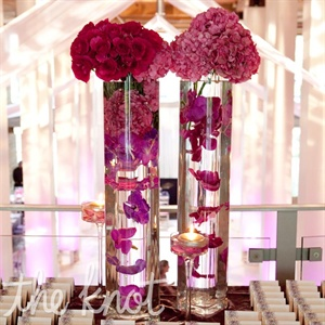 The display included submerged orchids in tall glass cylinder vases to match the modern reception decor.