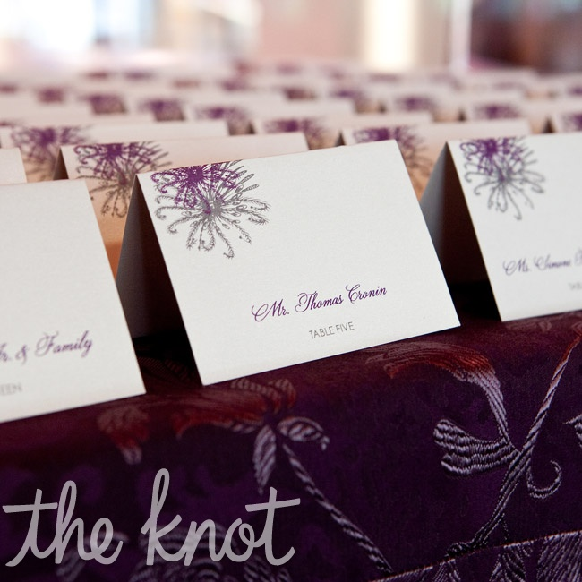 The escort cards featured the same purple floral design as the invitations.