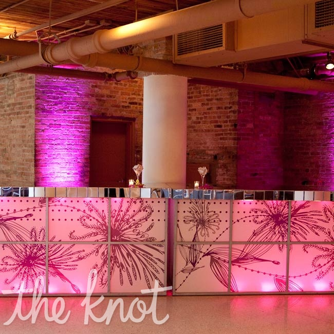 The reception's focal point was the bar: a custom creation with a mirrored top and a pink, patterned front (the design was borrowed from the invites).