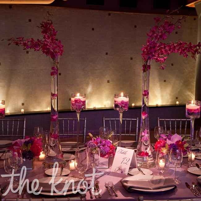 Tall and short arrangements unified by their sleek design decorated the head table.