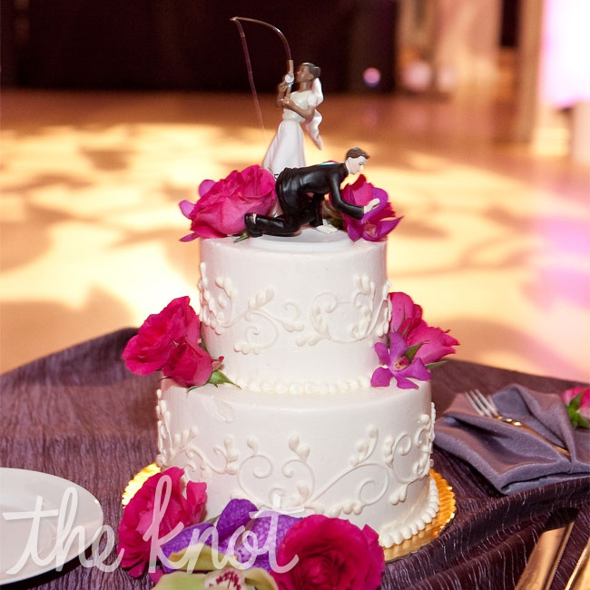"Colorful flowers and a topper depicting a bride ""fishing"" for a groom added pizzazz to the traditional white cake."