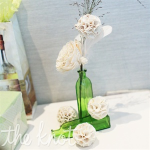 Instead of fresh blooms, the centerpieces were made from sola wood flowers.