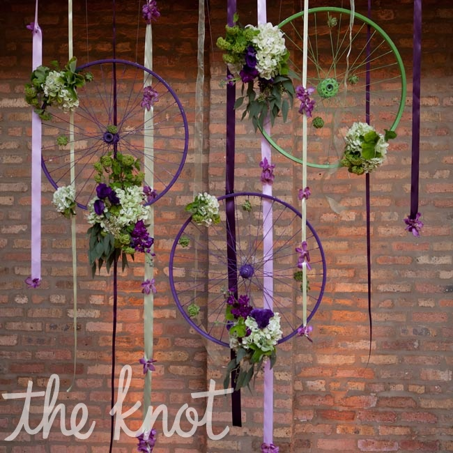 Hanging bike wheels painted and strung with flowers served as the altar.