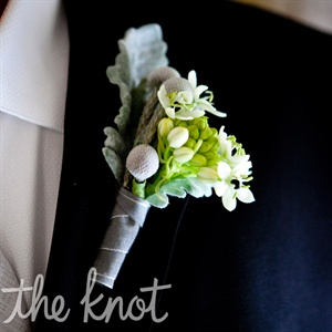 Matt's boutonniere had some of the same flowers as Melissa's bouquet.