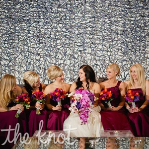 Each of Jessica&#39;s six bridesmaids chose her own dress style in the same rich sangria-purple color.