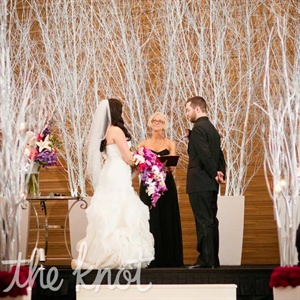Tall white birch trees set aglow by soft lighting added a winter-wonderland vibe.