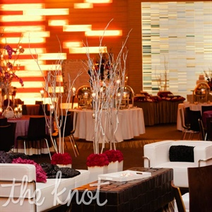 Wanting their reception to feel like a nightclub lounge, the couple decked out their space in high white benches and sleek couches.