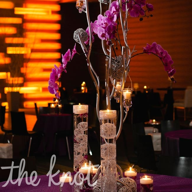 Silver trees adorned in fuchsia orchids, candles, and wire balls topped the large reception tables.