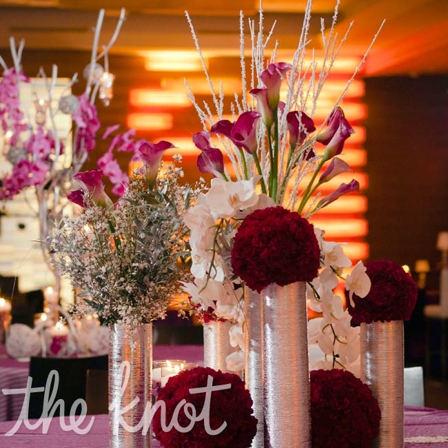Deep fuchsia pomanders, held in silver vases, packed a bold punch in the reception space.