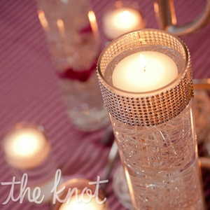 Clusters of dimly lit candles helped to cozy up the couple&#39;s winter theme.