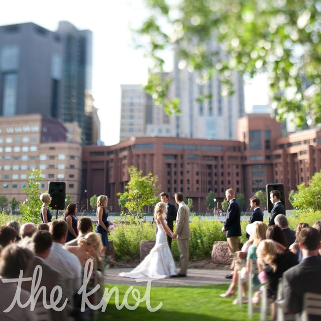 Krystina and Scott said their vows outside, standing before a few trees and views of downtown St. Paul.