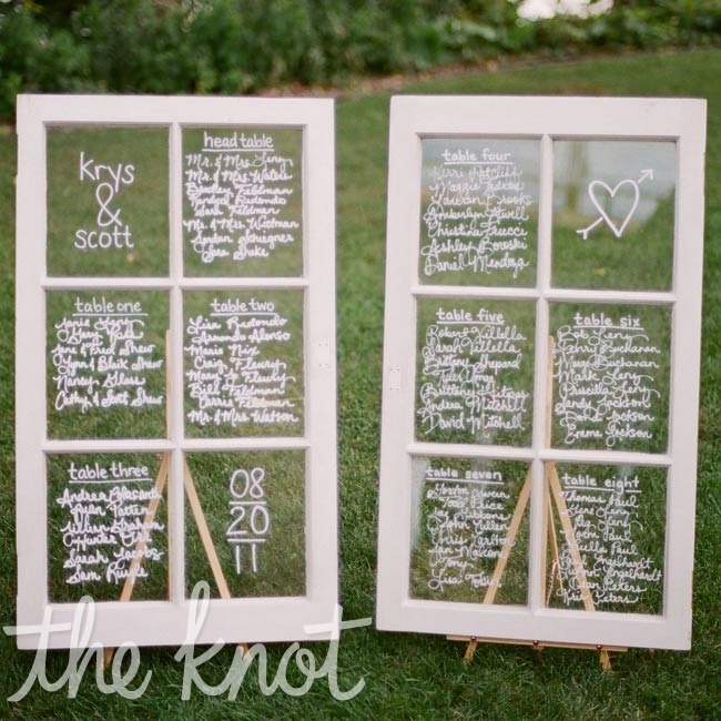 Taking an idea she had seen from Etsy, Krystina handwrote seating arrangements on two antique windows.