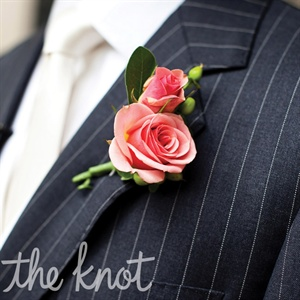 Christian's boutonniere was made up of small roses with subtle green accents.