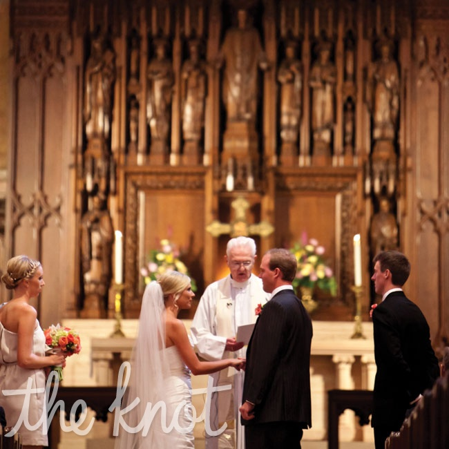 Surrounded by stained-glass windows and ornate woodwork, the couple married in a church ceremony.