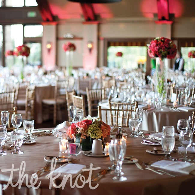 Alternating high and low centerpieces gave depth to the round reception tables.