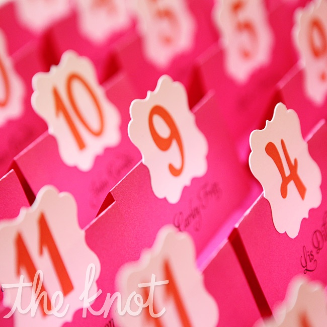 The couple worked together to assemble these pink-and-orange escort cards, which were designed by Emily.