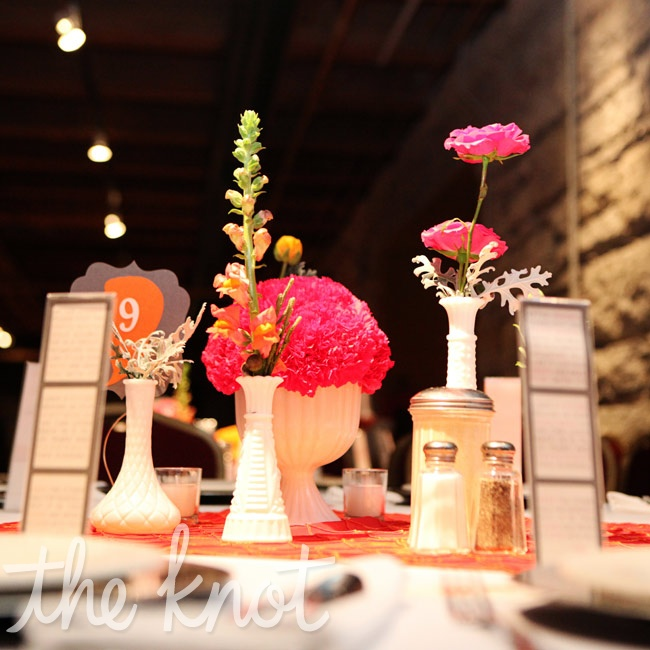 The couple shook up their tablescape with mix-and-match milk-glass vases filled with a variety of blooms.