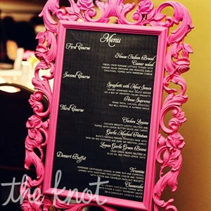 An antique-style menu display frame was painted hot pink to go along with the bright, festive color palette.