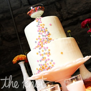 Playful fondant dots, punched out to look like confetti, cascaded down the side of the two-tiered cake.