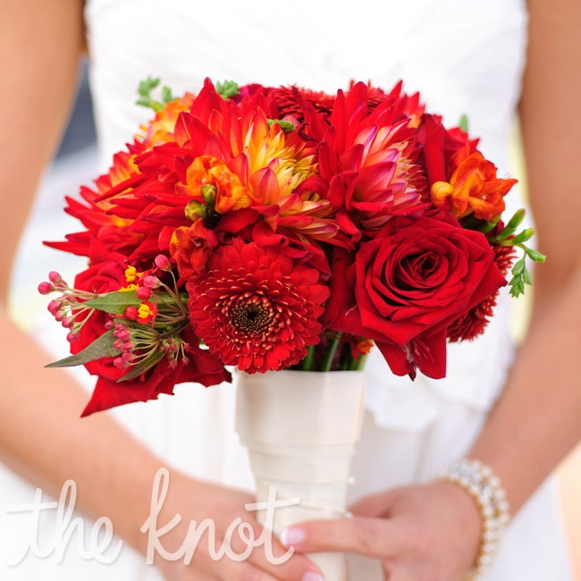 Gretchen didn't have any specific flowers in mind for her bouquet, so she simply asked her florist to assemble a red arrangement with lots of texture and variety.