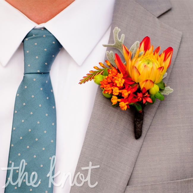 Nathan's fiery gold-and-orange boutonniere popped against his neutral gray attire.