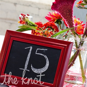 Table numbers were written on red-framed chalkboards for a rustic, homespun feel.