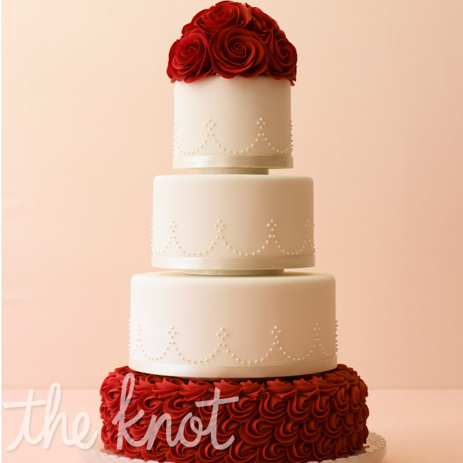 Create serious drama with contrasting colors, like dark-red sugar roses and piping against and all-white wedding cake. Cake by Mark Joseph Cakes