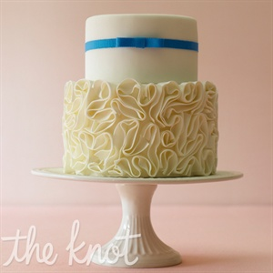 Ribbon is a fresh and easy way to add color. When you have a cake that already has a lot going on (like ruffled fondant), keep the extras to a minimum. Cake by Eat Cake Be Merry
