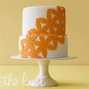 Go bold with flower appliques for an offbeat wedding. Cake by A Little Imagination Cakes