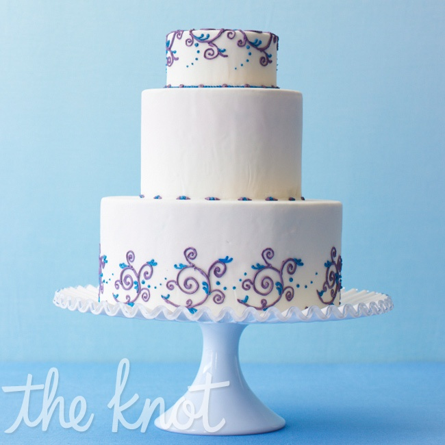 A henna-inspired scrollwork design works best in small doses. Try it on just the very top and bottom tiers of your cake. Cake by Love Street Cakes