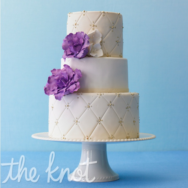 Sugar flowers are one of the most popular ways to bring in some color on a wedding cake -- and will give the design a traditional feel. Cake by A Little Imagination Cakes