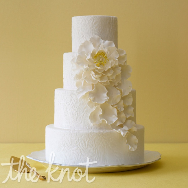 A barely there hue on an allwhite wedding cake makes for a classic and refined look. Cake by Ana Parzych Custom Cakes