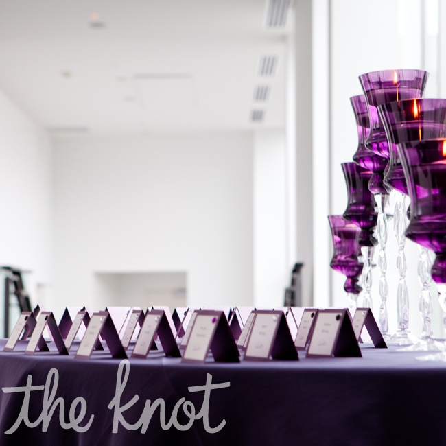 The purple candle holders on the place card table caught the attention of the guests. The place cards displayed the name and food selection for each of their guests. Rebecca and Shane carried their theme colors throughout every detail at their wedding.