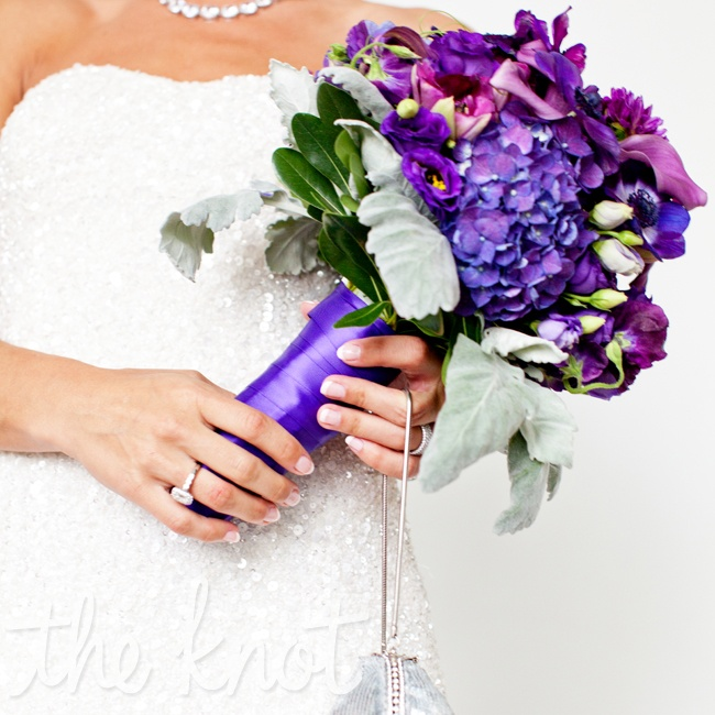 Rebecca carried a purple wedding bouquet made up of seasonal spring flowers like hydrangeas, lisianthus and calla lilies.