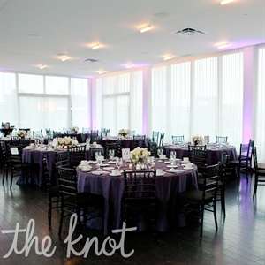 The purple up lighting and the purple tablecloths gave their reception room the elegant sophisticated look they were trying to accomplish.