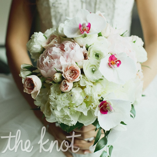 Sarah's elegant bridal bouquet included orchids, roses and hydrangeas with pink peonies.