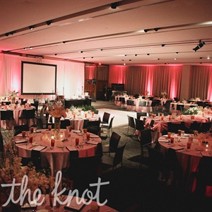 The reception room at the W Hotel included pink up lighting and pink tablecloths. For the centerpieces Sarah chose a combination of tall and short centerpieces.