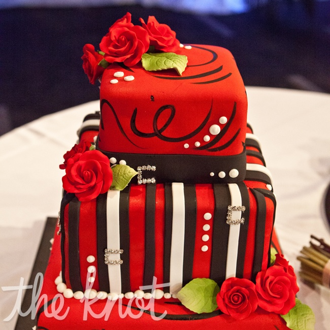 Tammie and Jonathan chose a three tier fondant cake decorated with sugar flowers, swirls, and fondant stripes which represented their unique style.
