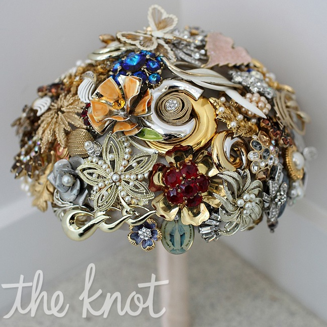 Amy honored her grandmother by caring a bridal bouquet that was made from old brooches and jewelry that were collected by her mother, her business partner Amy Steil and herself.