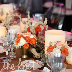 Amy and Joe had a mix of very different tables and décor for their guest tables. This version included suede napkins, grape wood, West Elm candles, cacti, garden roses, chargers, and gold silverware.